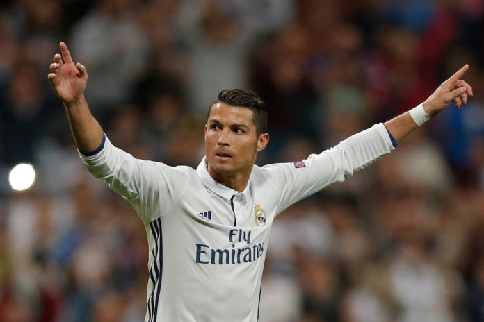 Real Madrid's Cristiano Ronaldo celebrates scoring his side's first goal during a Champions League, Group F soccer match between Real Madrid and Sporting, at the Santiago Bernabeu stadium in Madrid, Spain, Wednesday, Sept. 14, 2016. Real Madrid won with a 2-1 score. (AP Photo/Daniel Ochoa de Olza)